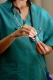 Doctor preparing serum. Detail of a doctor preparing serum Stock Photos