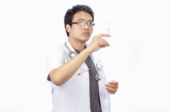 Doctor preparing a syringe on a white background Royalty Free Stock Image