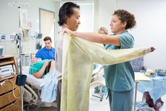 Doctor Preparing to Deliver Baby in Hospital Stock Images