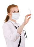 Doctor preparing vaccination injection. Royalty Free Stock Image