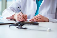 The doctor with prescribed medicines in medical concept Stock Photo