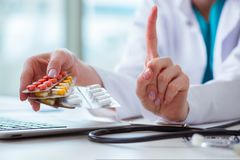The doctor with prescribed medicines in medical concept Stock Images
