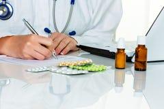 Doctor prescribes a drug Royalty Free Stock Photos