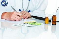 Doctor prescribes a drug Stock Image