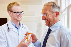Doctor prescribes medicament to patient Royalty Free Stock Photo