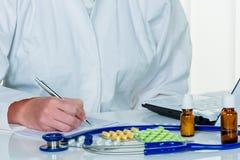 Doctor prescribes a medication Royalty Free Stock Photos