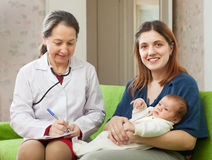 Doctor of prescribes to baby the medication Royalty Free Stock Photo