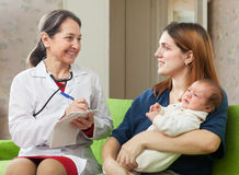 Doctor of prescribes to baby the medication Royalty Free Stock Images