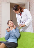 Doctor of prescribes to patient Stock Images