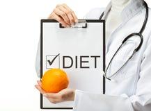 Doctor prescribing diet stock photos