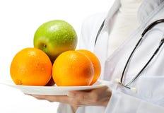 Free Doctor Prescribing Healthy Eating Stock Photo - 23670330