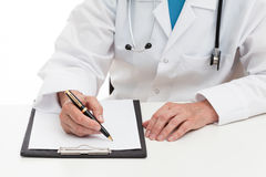 Doctor prescribing medicament Royalty Free Stock Photos