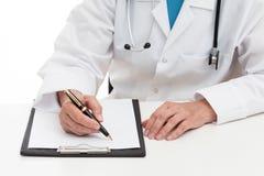 Doctor prescribing medicament Royalty Free Stock Photos