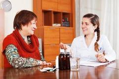 doctor prescribing medication to mature woman Stock Image