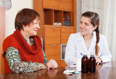 Doctor prescribing medication to senior woman Stock Photography