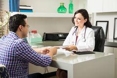 Doctor prescribing medicine to patient Stock Image