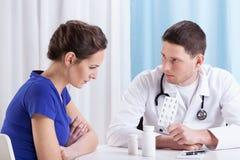 Doctor prescribing medicine Stock Photo