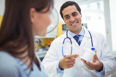 Doctor prescribing medicines to female patient Royalty Free Stock Images