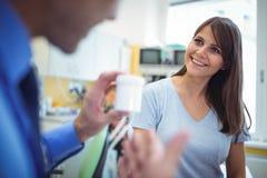 Doctor prescribing medicines to female patient Stock Image