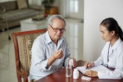 Doctor prescribing pills for treatment royalty free stock photography