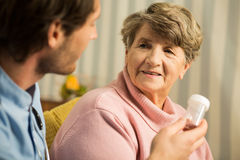 Doctor prescribing senior woman medicament Stock Photo