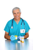 Doctor with Prescription Bottles Royalty Free Stock Photos
