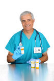 Doctor with prescription bottles Stock Image