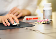 Doctor  prescription online medicine. In her office Royalty Free Stock Photos