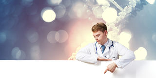 Doctor presenting banner Royalty Free Stock Images