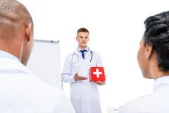 doctor presenting first aid kit stock image