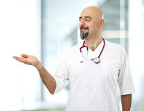 Doctor presenting a product Stock Images