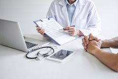 Doctor presenting report of diagnosis, symptom of disease and recommend something a method with patient treatment, after results. About the problem illness of royalty free stock photography