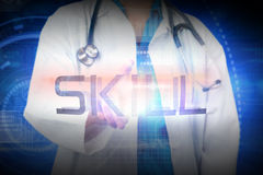 Doctor presenting the word skill Royalty Free Stock Photos