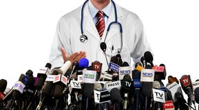 Doctor press conference with the media. Over white Royalty Free Stock Photos
