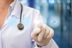 Doctor pressing the email button . stock illustration