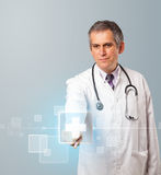 Doctor pressing modern medical type of button Royalty Free Stock Photos