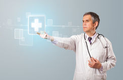 Doctor pressing modern medical type of button Royalty Free Stock Photography