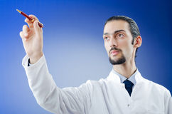 Doctor pressing virtual button Stock Photo