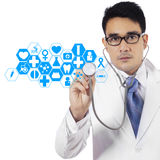 Doctor pressing virtual screen Royalty Free Stock Photography