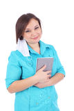 Doctor. Pretty young female doctor with the grey book and protective mask royalty free stock image