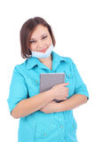 Doctor. Pretty young female doctor with the grey book and protective mask stock photos