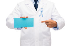 Doctor with prostate cancer awareness ribbon Royalty Free Stock Image