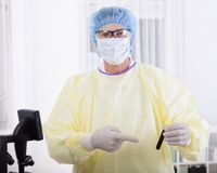 Doctor in protective gear holding blood sample Royalty Free Stock Photography