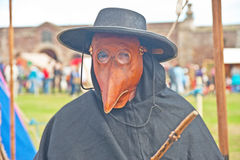 Doctor in protective mask. Authentic mask used in times of plague seen at ' Celebration of the Centuries ' held at Fort George on 11 th August 20-13 Stock Images