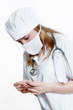 Doctor in protective mask with thermometer Stock Photos