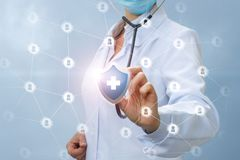Doctor provides health care network . Doctor provides health care network on blue background stock images