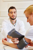 Doctor during provision examination Royalty Free Stock Photo