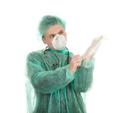 Doctor pulling on surgical gloves Stock Photo