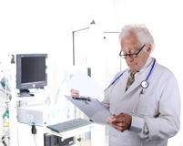 Doctor in pulmonary function lab looking at a clipboard Stock Image