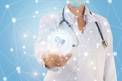 Doctor pushes the Medication button . Doctor pushes the Medication button in the network connections Royalty Free Stock Image